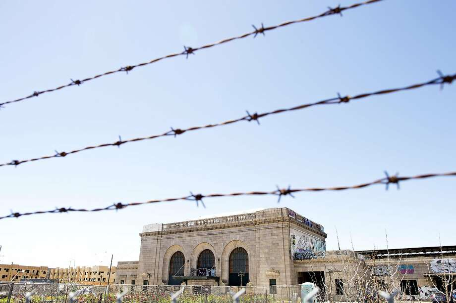 A fence surrounds the Oakland 16th Street Station. Photo: Noah Berger, Special To The Chronicle