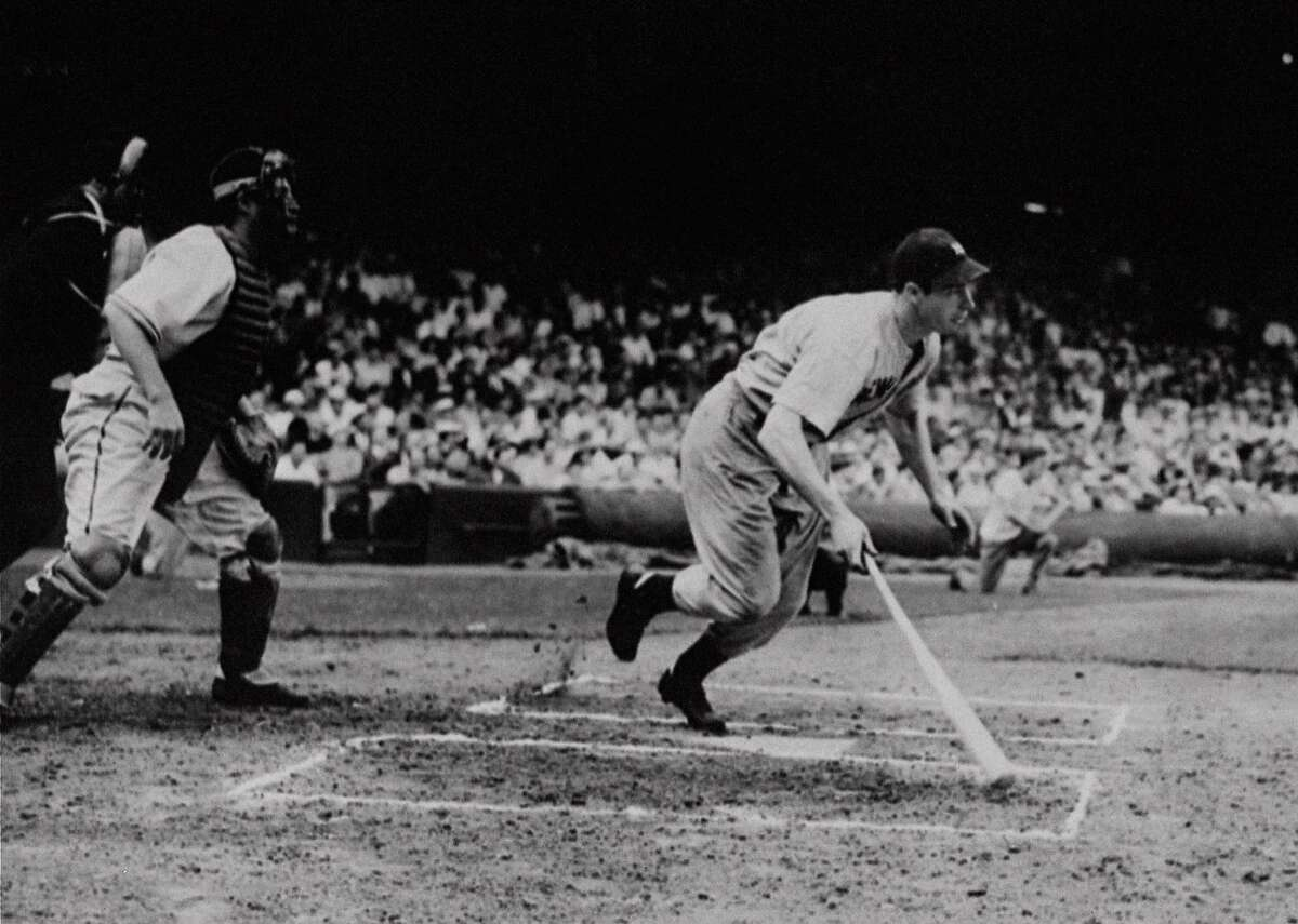 Yankee outfielder Joe DiMaggio singles in the first inning of a game with the Cleveland Indians at Cleveland, in this July 16, 1941, photo. It was the 56th straight game in which he got a hit. Every so often, a hitter pieces together a streak, 10 games, 20 games, maybe even 30. And that's when people start thinking about the summer of 1941, when Joe DiMaggio hit in 56 straight. (AP Photo/File)