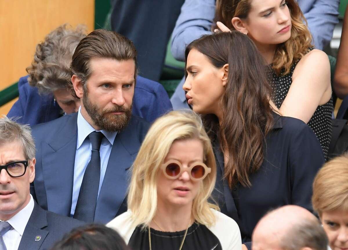 Wimbledon cameras capture this unusual moment between Bradley Cooper and Irina Shayk, Sunday, July 10, 2016.