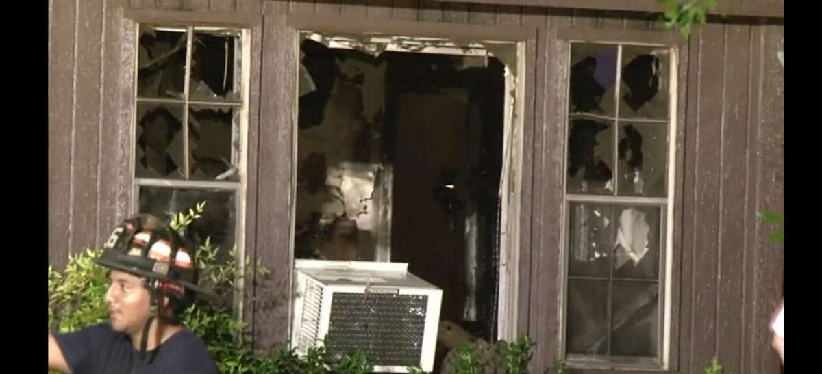 Flames ripped through a home about 11:30 p.m. Monday, July 11, 2016, on Battlepine near Woodland Oaks in northwest Harris County. (Metro Video)