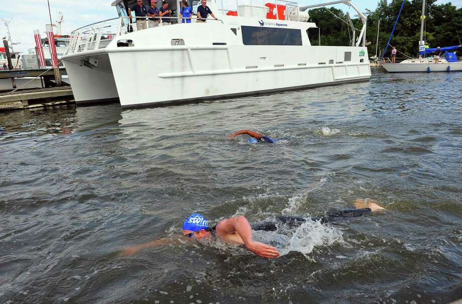 St. Vincent's 28th Annual SWIM Across the Sound marathon at Captain's Cove Seaport in Bridgeport, Conn., on Saturday July 25, 2015. This year's SWIM marathon, which takes place July 30, is in need of boat captains to escort swimmers from Port Jefferson to Captain's Cove in Bridgeport and to create a safety perimeter around the field. Photo: Christian Abraham / Hearst Connecticut Media / Connecticut Post