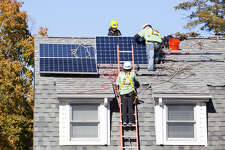 Volunteers from Viridian work in October 2015 with installers from GRID Alternatives on a solar energy system in Port Chester, N.Y. (Photo: Business Wire)