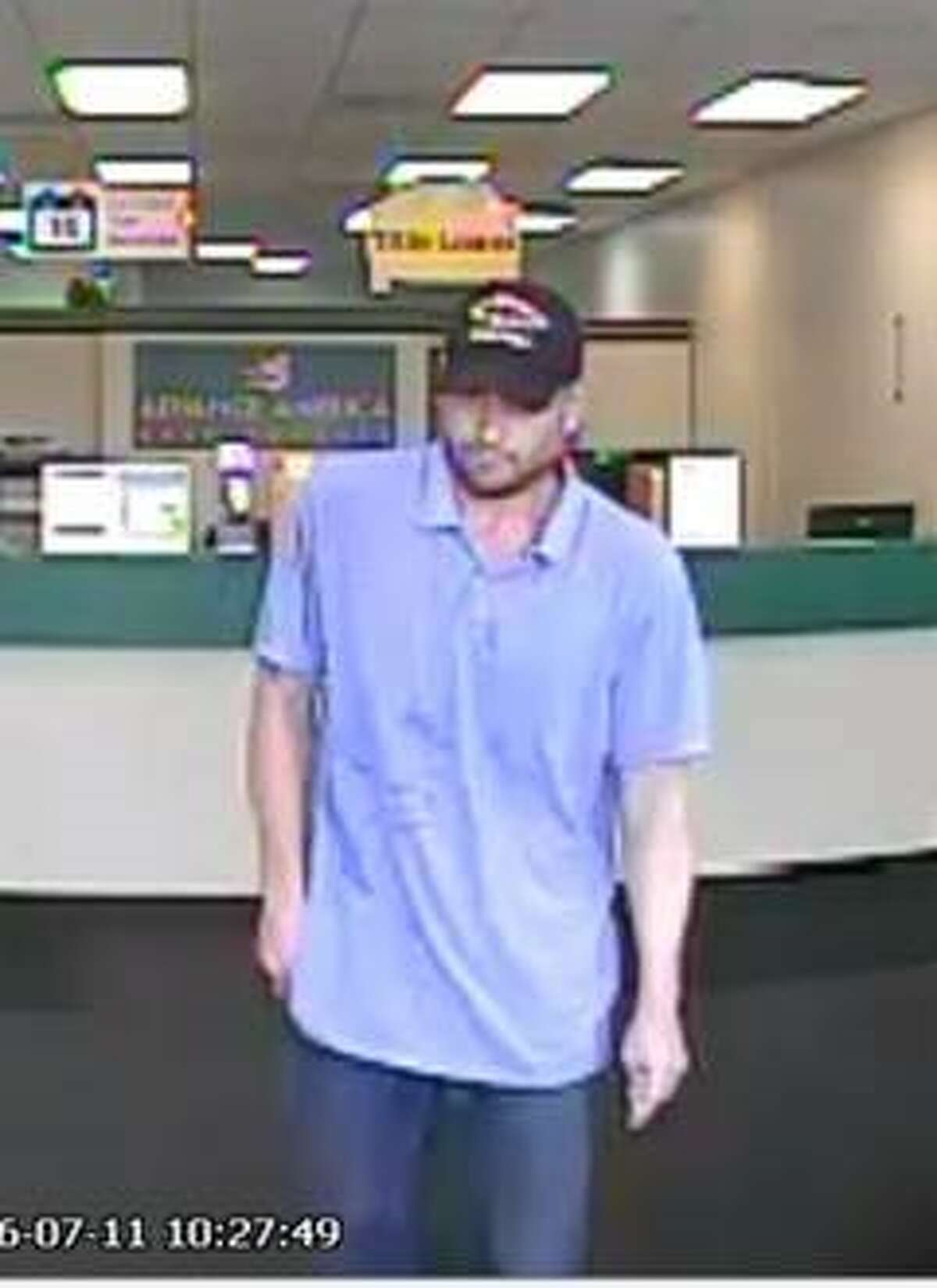 Surveillance photograph of a suspect in a robbery about 10:30 a.m. Monday, July 11, 2016, at an America Cash Advance store at 153 FM 518 in Kemah. (Galveston County Crime Stoppers)