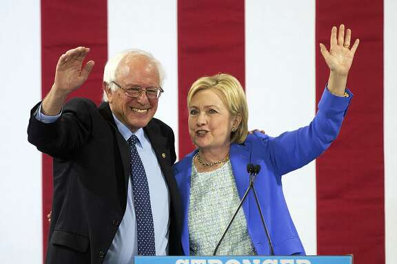 Democratic presidential candidate Hillary Clinton waves to supporters with Sen. Bernie Sanders, I-Vt., during a rally in Portsmouth, N.H., Tuesday, July 12, 2016, where Sanders endorsed her for president. (AP Photo/Jim Cole)