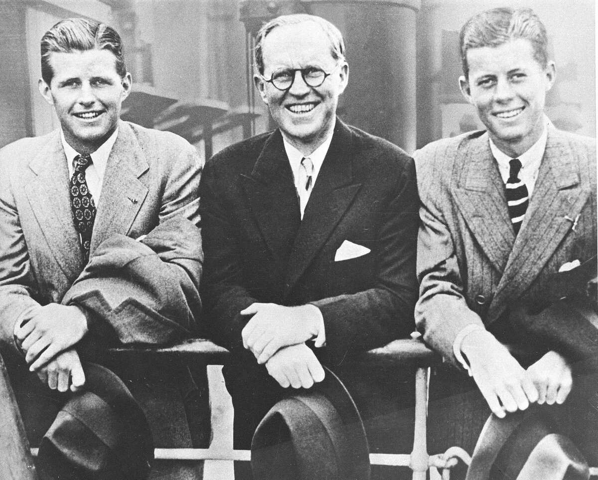 U.S. Ambassador to Great Britain Joseph P. Kennedy, center, is flanked by his sons, Joseph P. Kennedy Jr., left, and John F. Kennedy, right, as he poses aboard an ocean liner in this 1938 photograph. (AP Photo)