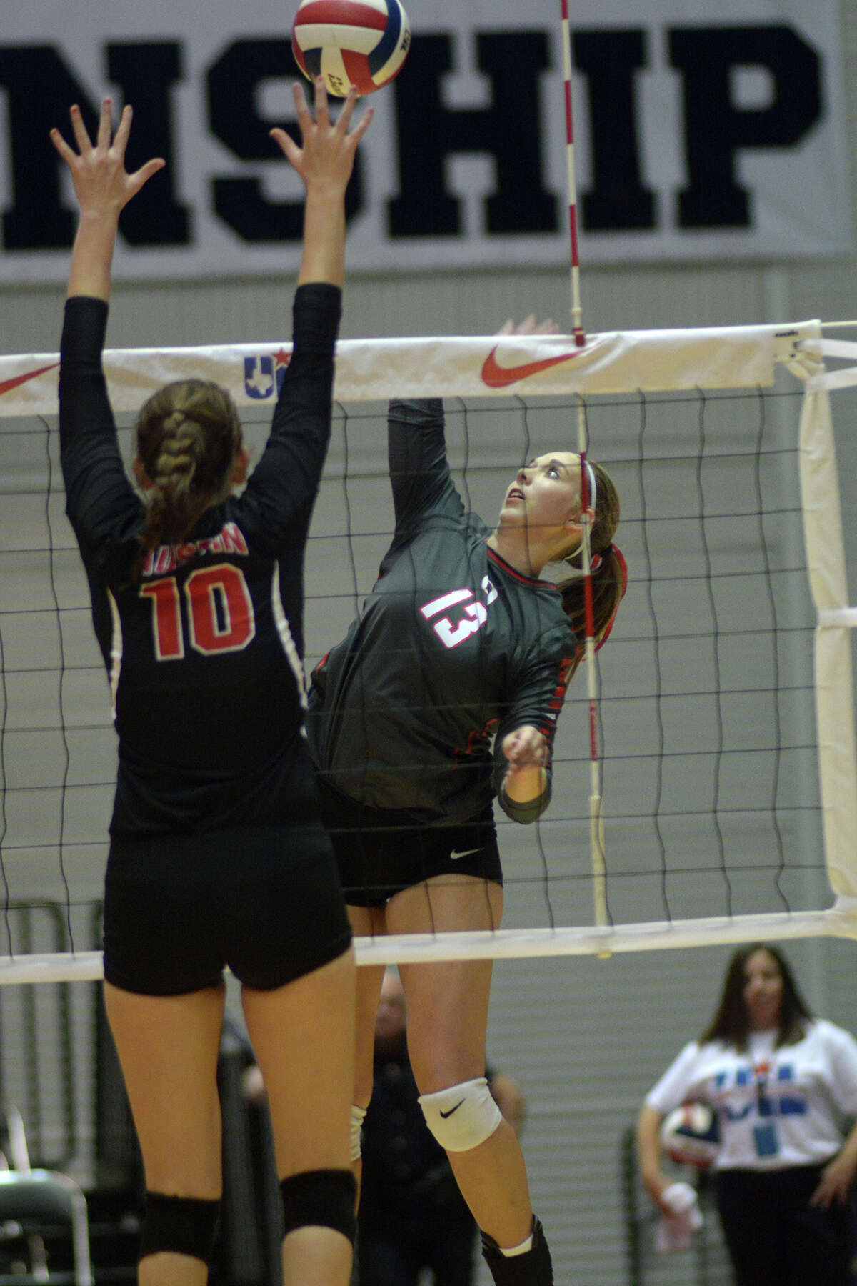 Oak Ridge junior Brooke Clark (13) goes one-on-one at the net against Fort Bend Austin senior Erin Mulcahey (10) during their Class 6A semifinal matchup at the 2015 UIL Volleyball State Championships at the Curtis Culwell Center in Garland on Friday, Nov. 20, 2015. (Photo by Jerry Baker/Freelance)