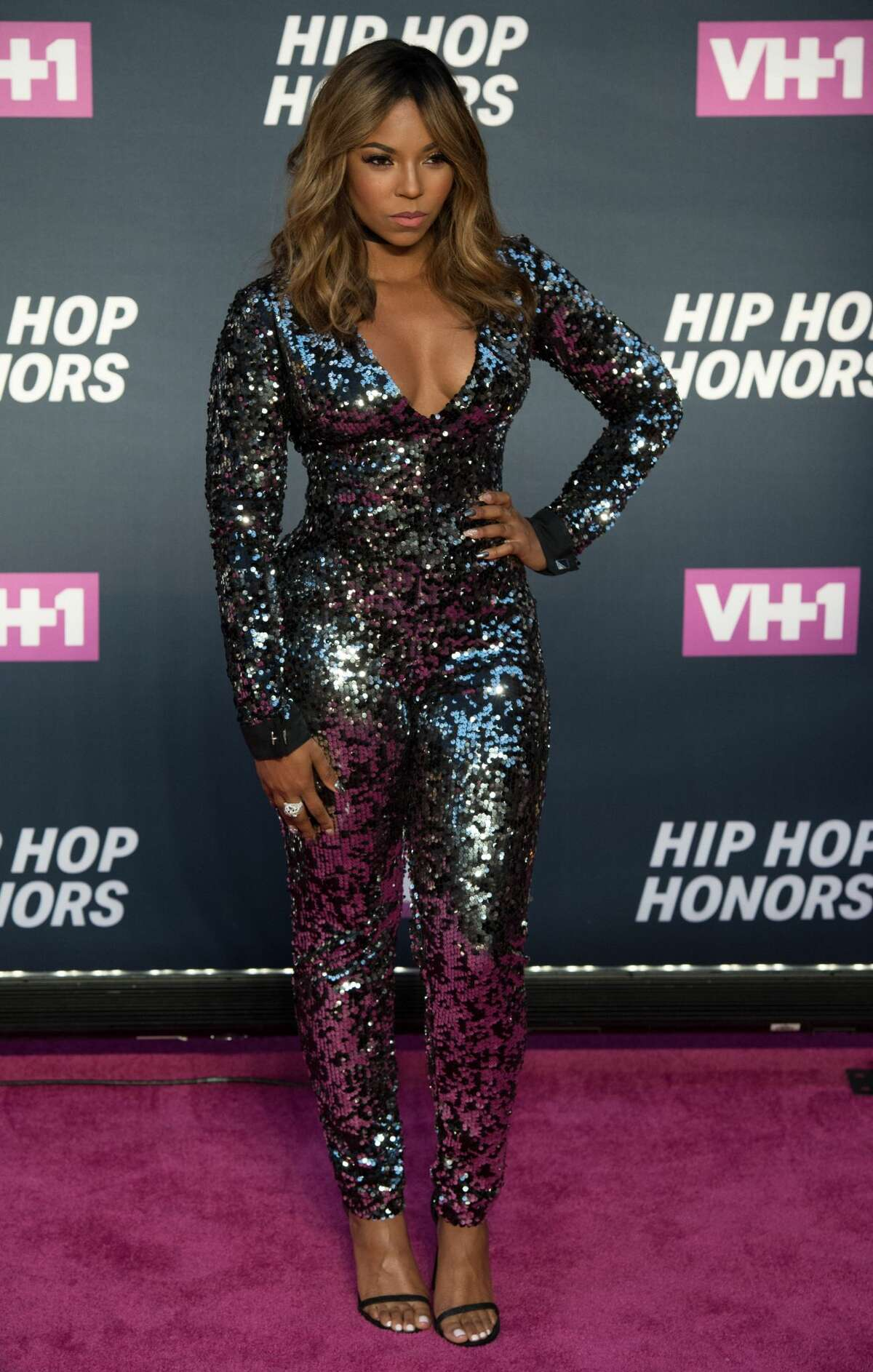 Ashanti now: We really need to see Ashanti more if she's going to wear amazing glitter catsuits all the time.