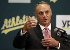 Baseball Commissioner Rob Manfred gestures during a media conference Friday, June 19, 2015, prior to a baseball game between the Los Angeles Angels and the Oakland Athletics in Oakland, Calif. (AP Photo/Ben Margot)