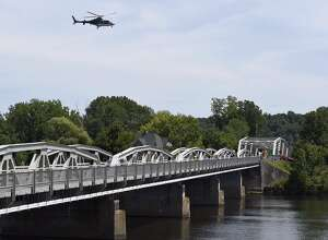 A State Police helicopter hovers over the Hudson River and the Stillwater Bridge as authorities search for a swimmer who may have disappeared after after jumping into the river. (Skip Dickstein / Times Union)