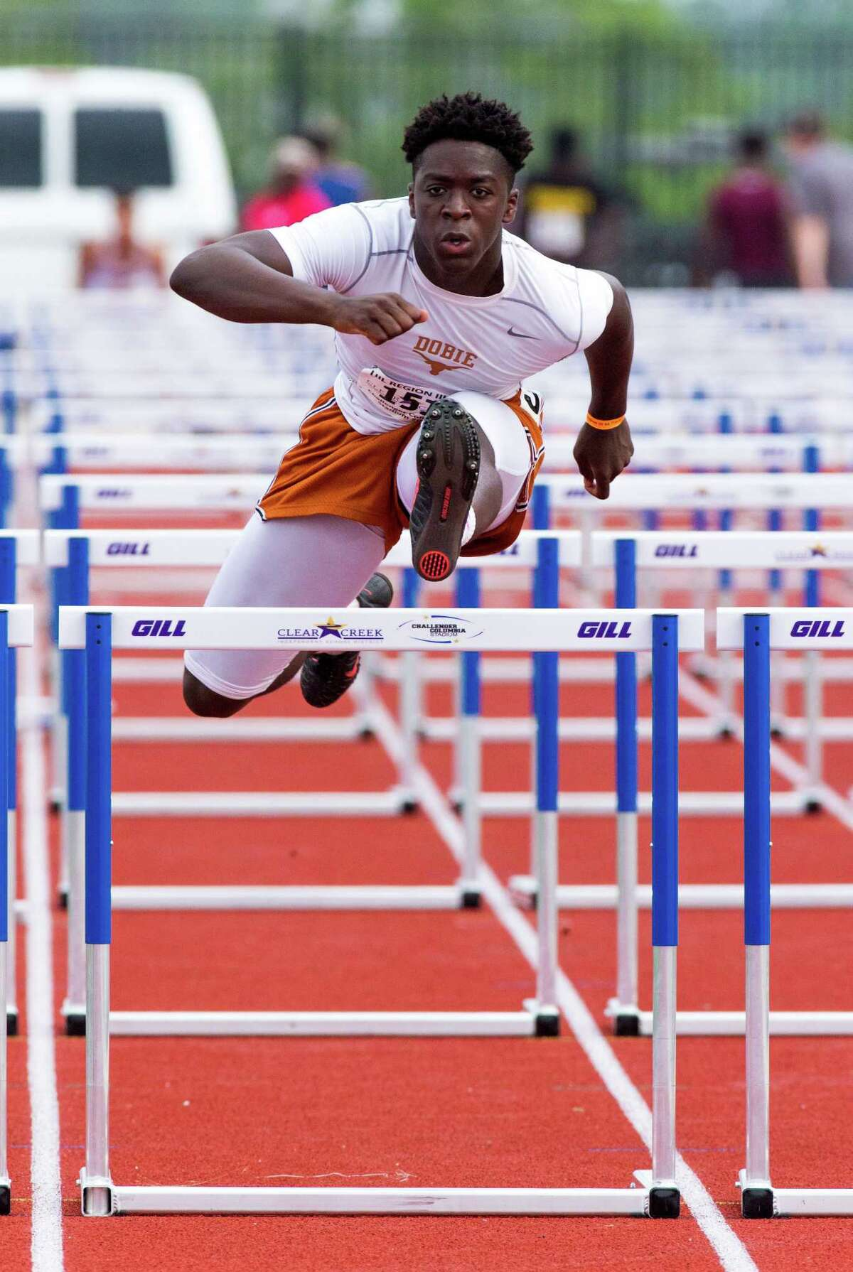 Jeremy Davis of Pasadena Dobie leaping over the hurdles during the 110 M Hurdles competition during UIL Region II 6-A Track & Field Championship at the Challenger Columbia Stadium, Friday, Apr. 29, 2016, in Houston. (Juan DeLeon / For the Houston Chronicle)