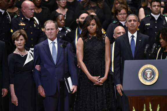 US President Barack Obama and First Lady Michelle Obama and former US president George W. Bush and former first lady Laura Bush attend an interfaith memorial service for the victims of the Dallas police shooting at the Morton H. Meyerson Symphony Center on July 12, 2016 in Dallas, Texas. / AFP PHOTO / MANDEL NGANMANDEL NGAN/AFP/Getty Images