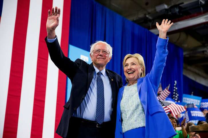Democratic presidential candidate Hillary Clinton and Sen. Bernie Sanders, I-Vt. wave to supporters during a rally in Portsmouth, N.H., Tuesday, July 12, 2016, where Sanders endorsed Clinton for president. (AP Photo/Andrew Harnik)