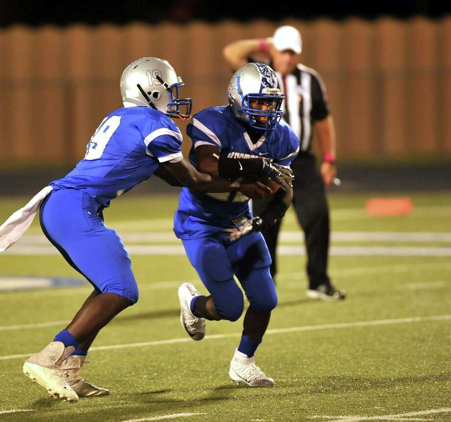 Westbury quarterback Travell Eman-Henshaw (19) and running back Myles Stennis (22) are two reasons that Huskies' new coach Greg Wilson has high hopes for a quick resurgence at his alma mater. Photo: Eddy Matchette, Freelance / Freelance