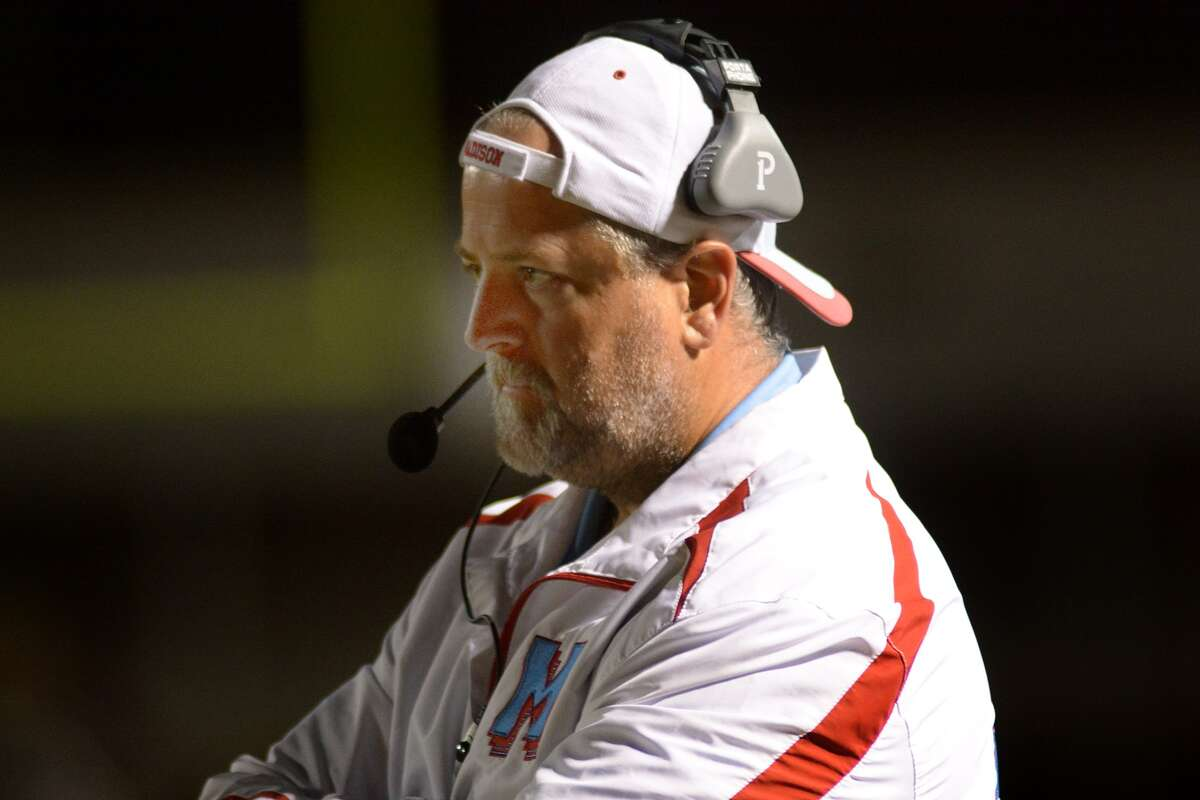 Madison head coach Pat Reinecke works the sideline against Magnolia West during their playoff game at Mustang Stadium in Magnolia on Nov. 13, 2015. (Photo by Jerry Baker/Freelance)