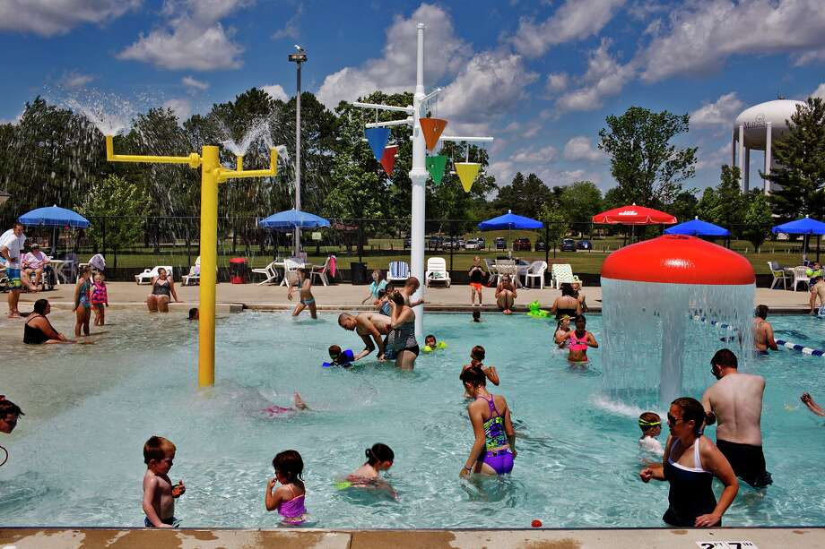 Patrons at the pool enjoy a splash on opening day at the Plymouth Park Pool on Saturday. Photo: Theophil Syslo