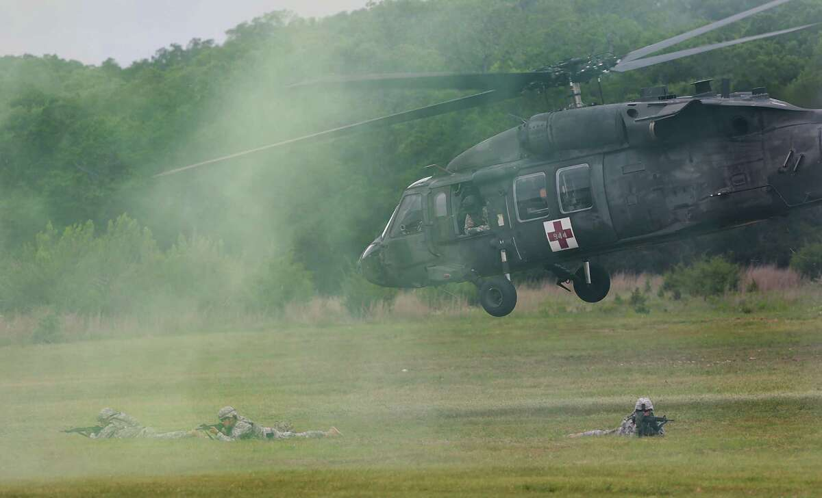 A team of troops hit the ground after being dropped by a Black Hawk helicopter during a competition at Camp Bullis in this 2013 file photo.