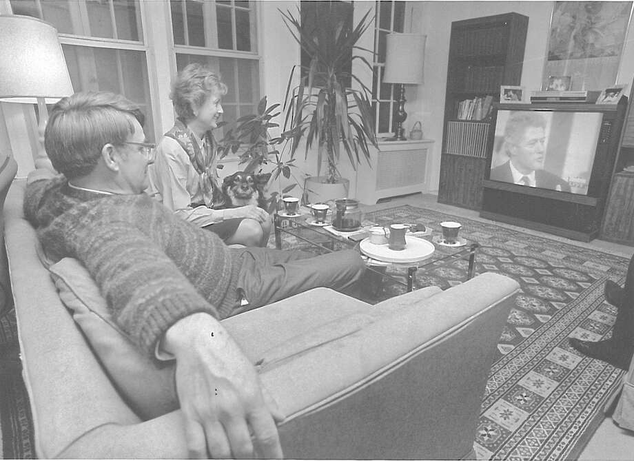 Bob Marchand and Stephanie Orange watch President Bill Clinton's economic address on television at the Marchand residence on Perry Ridge Road on Feb. 17, 1993. Photo: Paul Desmarais