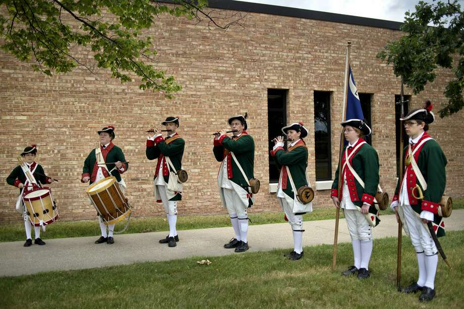 "Members of the Tittabawassee Valley Fife and Drum Corps perform during a dedication of the U.S. Navy Corpsman Aaron Ullom memorial bridge on Saturday at the Midland Armory. Two signs reading ""Corpsman Aaron D Ullom Memorial Bridge"" will be placed on U.S. 10 at the Eastman Avenue bridge. Ullom was killed in action on July 12, 2011, while serving in Helmond Province, Afghanistan. Photo: Nick King/Midland  Daily News/Nick King"