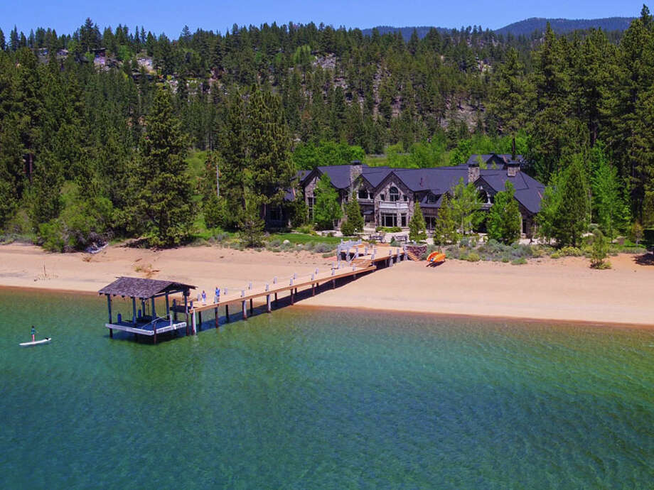 """This lakefront Tahoe estate featured on 'Bonanza' hit the market for $59 million in 2016 and is now listed for $47 million. It """"includes 378 lineal feet of sandy beach with a private pier, boat hoist, 2 boat buoys and close-up views of Lake Tahoe and the Sierra Nevada mountains to the West."""" Photo: Steve Mitchell, EMedia Films"""