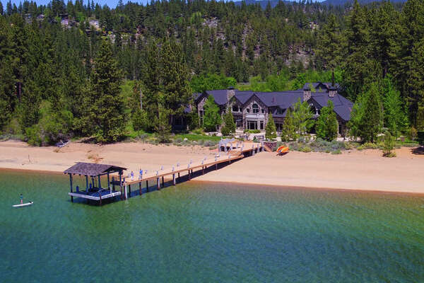 """This lakefront estate in Zephyr Cove, Nev., """"includes 378 lineal feet of sandy beach with a private pier, boat hoist, 2 boat buoys and close-up views of Lake Tahoe and the Sierra Nevada mountains to the West,"""" according to theSotheby's website."""