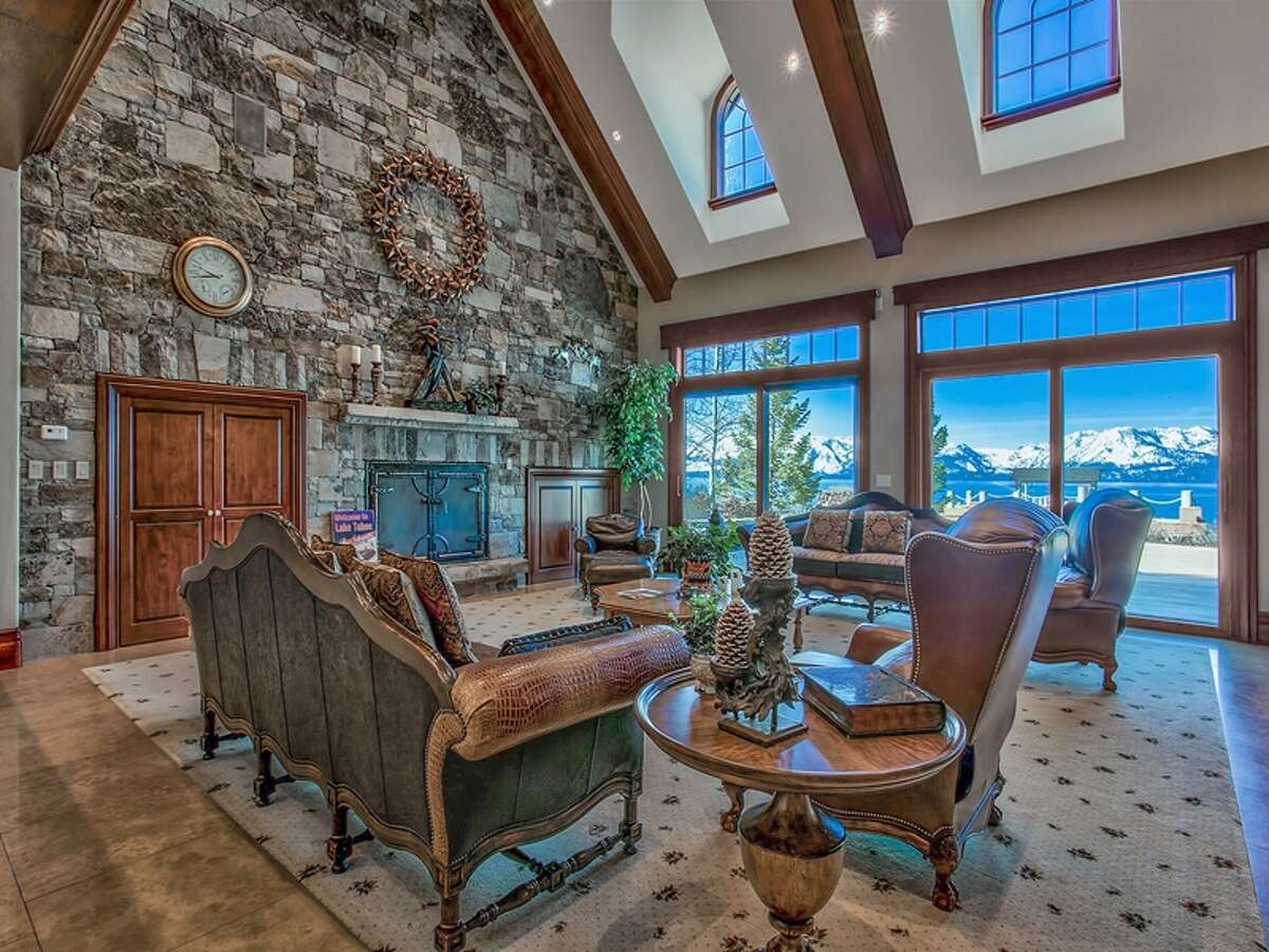 In the living room, windows overlook the lake.