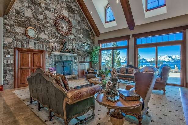 "A formal lodge-style home in Zephyr Cove, Nev., is on the market for $59 million. ""The 16,703 square foot main home features a grand foyer with circular staircase leading to the second floor, and opens to the great room on the main level,"" according to the Sotheby's website."