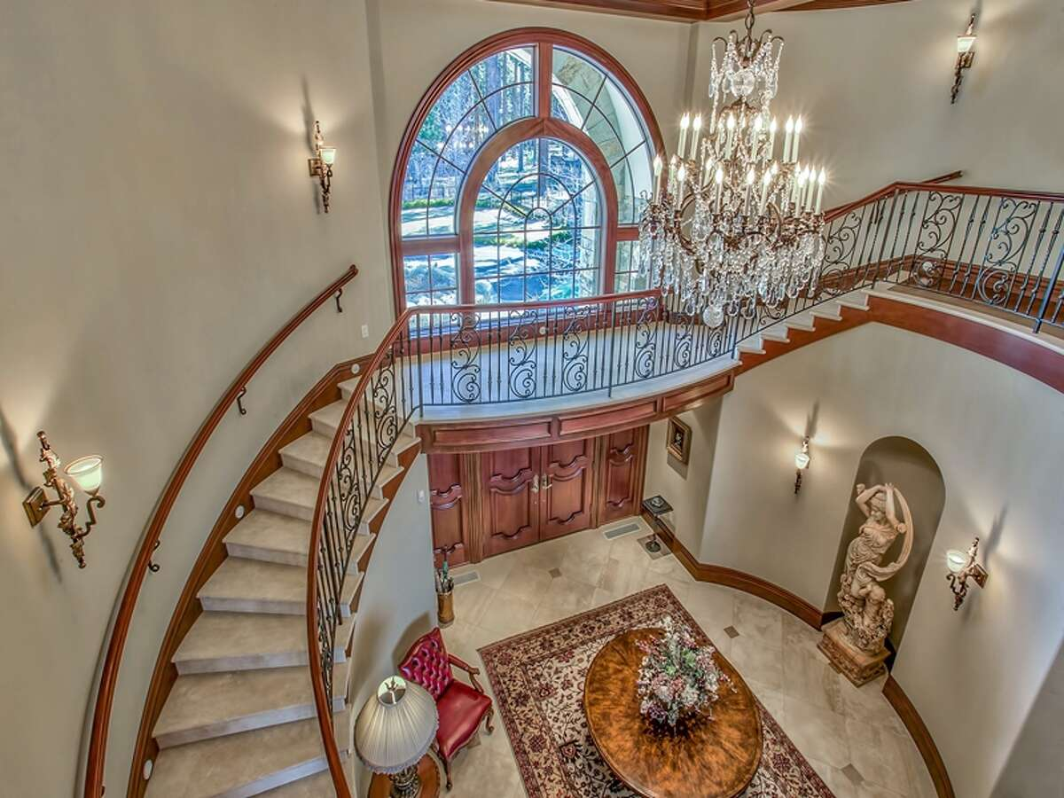 Built in 2004, the property at 550 and 560 Sierra Sunset Lane is majestic and formal. You get a sense of its grandeur as soon as you walk through the entry where a crystal chandelier hangs and a circular staircase leads to the second floor.