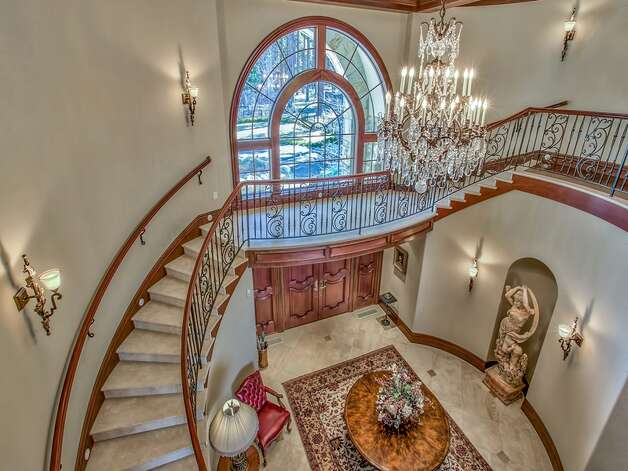Built in 2004, the property at 550 and 560 Sierra Sunset Lane is majestic and formal. You get a sense of its grandeur as soon as you walk through the entry where a crystal chandelier hangs and a circular staircase leads to the second floor. Photo: Courtesy Sotheby's