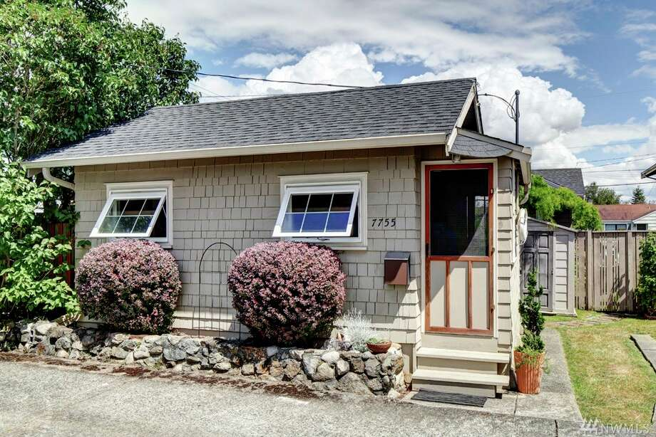 If this little home doesn't encapsulate Seattle outrageous home prices, we don't know what does.The tiny home in Ballard, 7755 Earl Ave. N.W., is just 360 square feet and listed for $300,000. That works out to a whopping $833 per square foot. The home is cute and well-maintained, but the price tag may not be worth it for some, especially when you can find condos that are nearly double the size for $85,000 less.The home sits at the back of a private lot and includes a yard that could be used as a small garden or patio. You can see the full listing here. Photo: Photos By Pete Hanson/Listing Courtesy Of Cynthia Creasey, Lake & Company