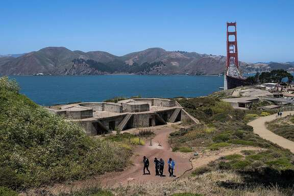 A group of tourists walk past Battery Godfrey at the Presidio in San Francisco, Calif. on Tuesday, July 12, 2016.