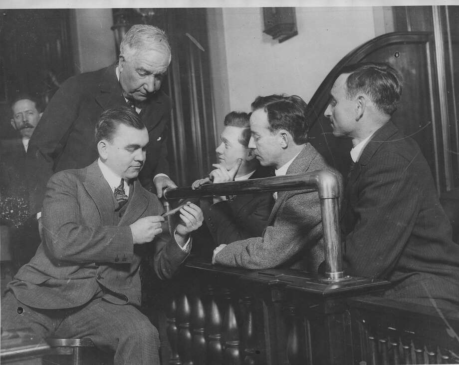 Defense attorney W. Bourke Cockran with Tom Mooney (holding a piece of metal), Warren Billings, Ed Nolan and Israel Weinberg at the 1917 trial. Mooney and Billings were wrongly convicted of the bombing.