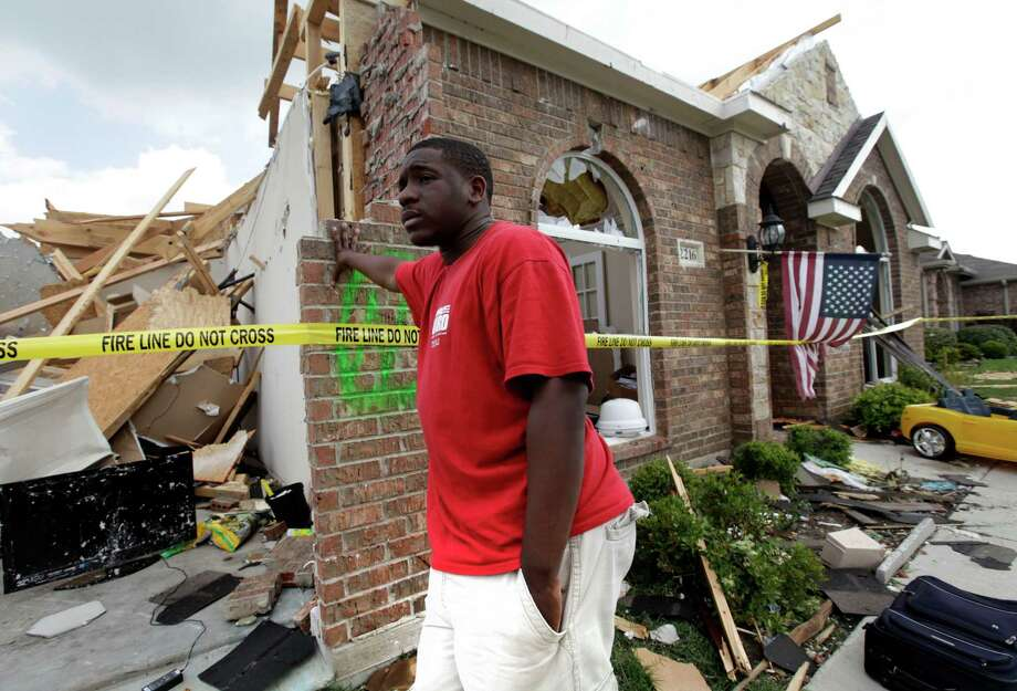 "Royal Thornton waits at his tornado-damaged house in Forney in 2012. Home insurance changes may be ahead. was hit by a tornado that left just the front part of the home standing. The mayor of Forney, Texas, says it's ""a real blessing"" that nobody was killed in the community by the tornadoes that ripped through parts of the Dallas area yesterday. Photo: Tony Gutierrez, STF / AP"