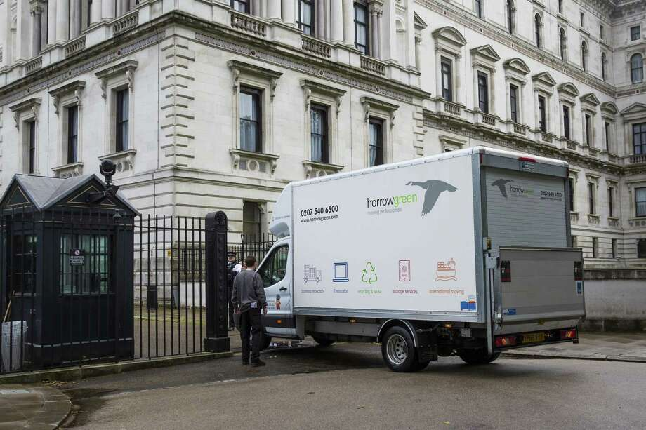 A truck enters 10 Downing Street on Tuesday in London to move British Prime Minister David Cameron's belongings. The new prime minister, Theresa May, will oversee the complex process of separating the nation from the European Union. Photo: Jack Taylor, Stringer / 2016 Getty Images
