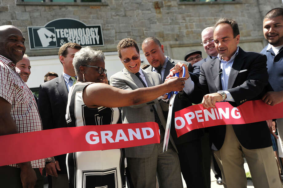 From left; State Senator Marilyn Moore, A+ Technology & Security Solutions President David Antar, New England headquarters Director Jorge Garcia, Bridgeport City Council President Tom McCarthy, and Bridgeport Mayor Joe Ganim cut the ribbon for the grand opening of A+ Technology & Security Solutions new satellite offices at 1027 Fairfield Avenue in Bridgeport, Conn. on Tuesday, July 12, 2016. The Long Island, NY based company is the security provider for the City of Bridgeport. Photo: Brian A. Pounds / Hearst Connecticut Media / Connecticut Post