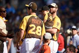 SAN DIEGO, CA - JULY 11:  Buster Posey #28 of the San Francisco Giants talks to Brandon Belt #9 of the San Francisco Giants during the T-Mobile Home Run Derby at PETCO Park on July 11, 2016 in San Diego, California.  (Photo by Denis Poroy/Getty Images)