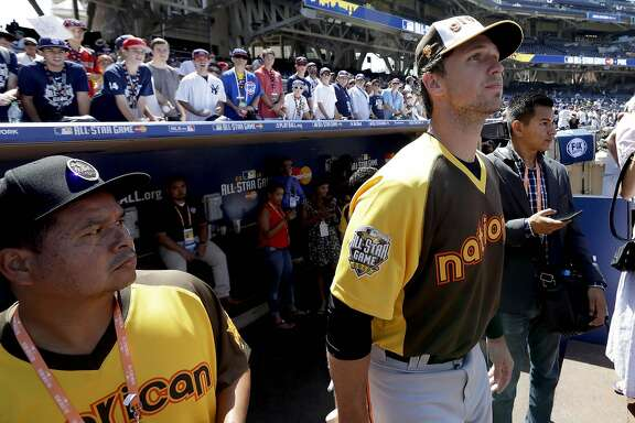 National League's Buster Posey, of the San Francisco Giants, watches from the dugout during batting practice prior to the MLB baseball All-Star game, Tuesday, July 12, 2016, in San Diego. (AP Photo/Jae C. Hong)