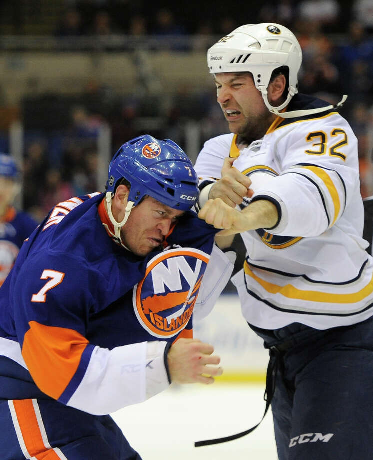 Matt Carkner (7) retired last week and will be a Sound Tigers' assistant. Photo: Kathy Kmonicek / Associated Press / ONLINE_CHECK