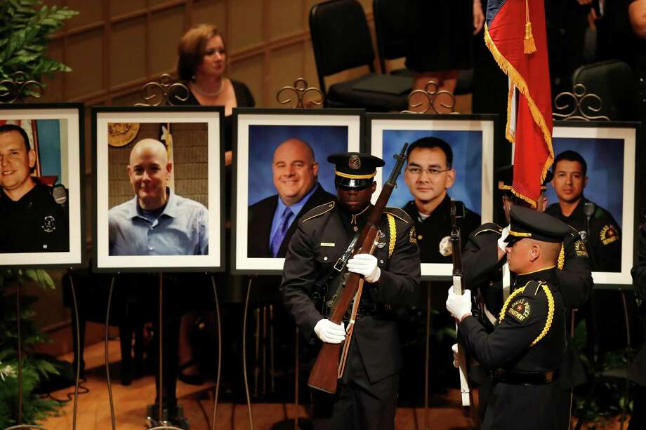 Portraits of the five fallen Dallas police officers are on display prior to a memorial service in Dallas Tuesday. Photo: Eric Gay, STF / Copyright 2016 The Associated Press. All rights reserved. This material may not be published, broadcast, rewritten or redistribu