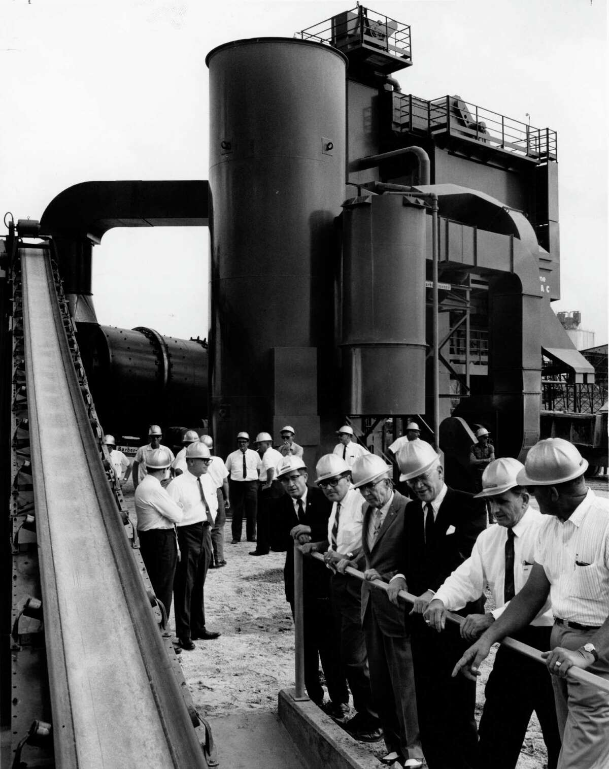 06/07/1965 - Brown & Root officials watch materials move to the company's new asphalt plant, 3600 Clinton Drive in Houston. From left are: L.J. Derrick; Don B. Smith; Marvin L. Woodfin; George R. Brown and Dalter Corbell.