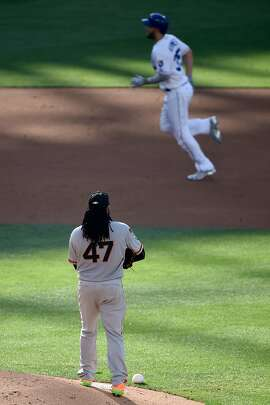 SAN DIEGO, CA - JULY 12:  Johnny Cueto #47 of the San Francisco Giants and the National League looks on as Eric Hosmer #35 of the Kansas City Royals and the American League rounds the bases after hitting a home run in the 2nd inning of the 87th Annual MLB All-Star Game at PETCO Park on July 12, 2016 in San Diego, California.  (Photo by Denis Poroy/Getty Images)