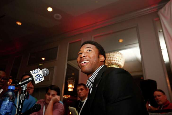 Texas A&M defensive linebacker Myles Garrett speaks to the media at the Southeastern Conference NCAA college football media days, Tuesday, July 12, 2016, in Hoover, Ala. (AP Photo/Brynn Anderson)