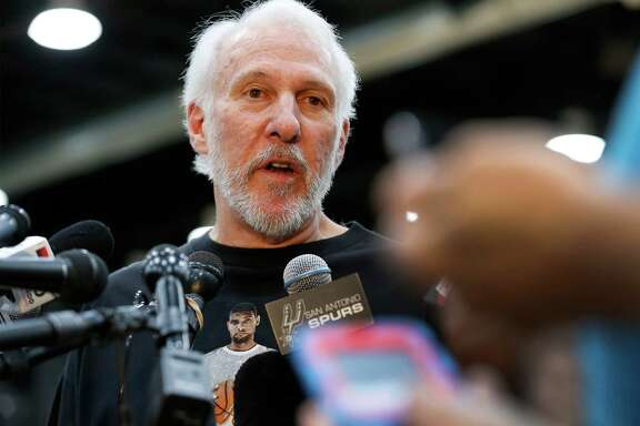 Spurs coach Gregg Popovich addresses the media a day after Tim Duncan announced his retirement from the game on Tuesday, July 12, 2016. Popovich wore a t-shirt with the likeness of Duncan as he reflected on his relationship with the 19-year Spurs veteran and talked about his contributions to the team and to him personally. (Kin Man Hui/San Antonio Express-News)