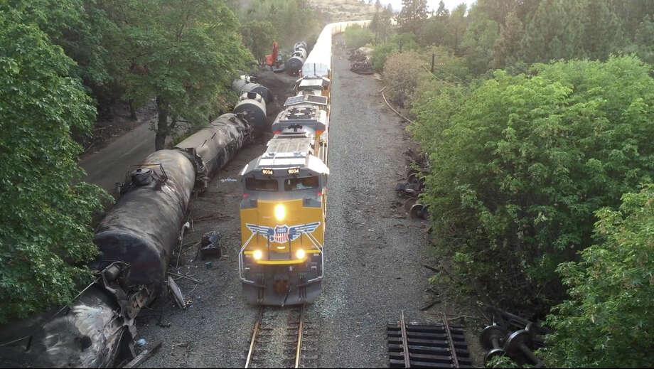 Crumpled oil tankers are beside the railroad tracks after a fiery June 3 derailment near Mosier, Ore.  Photo: Brent Foster, UGC / Brent Foster