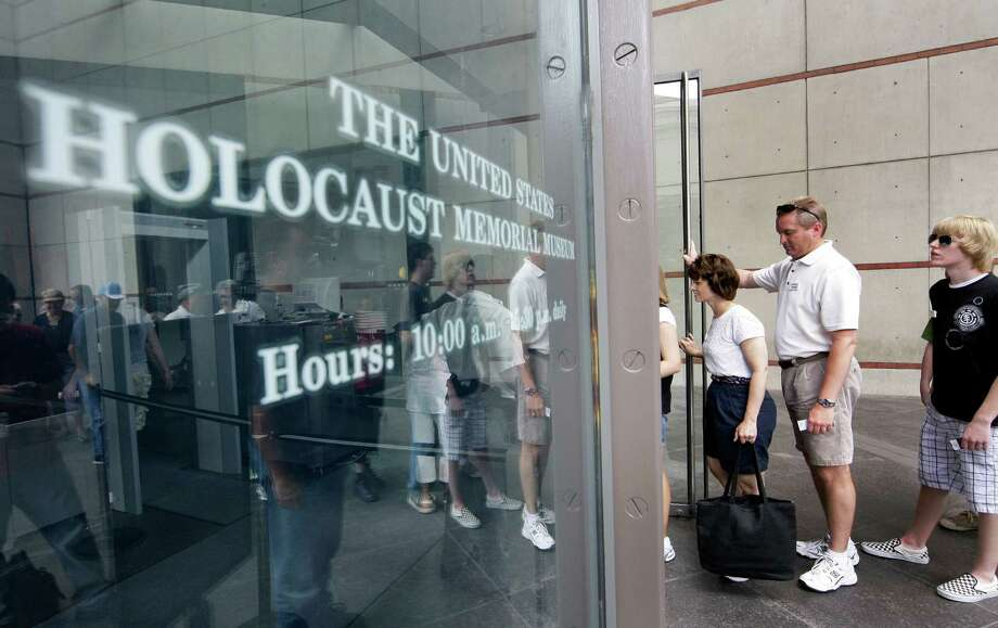 "Visitors line up to enter the U.S. Holocaust Memorial Museum in Washington. The U.S. museum is requesting that smartphone users not ""catch"" Pokémon inside the museum. Photo: Alex Brandon, STF / AP2009"