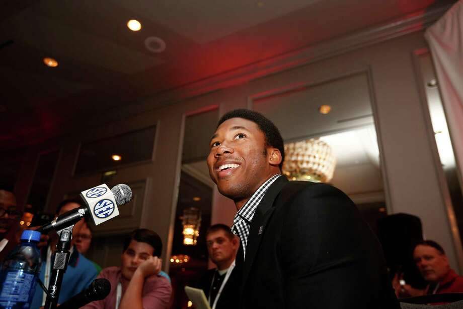 A&M's Myles Garrett enjoys his time in the media spotlight Tuesday. Photo: Brynn Anderson, STF / Copyright 2016 The Associated Press. All rights reserved. This material may not be published, broadcast, rewritten or redistribu