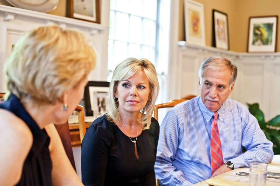 "Gretchen Carlson, center, with her attorneys Martin Hyman, right, and Nancy Erika Smith at Smith's home in Montclair, N.J., July 12, 2016. In a first public statement since her sexual harassment suit against Fox News boss Roger Ailes, Carlson said that she felt it was finally time to speak up. ""I just wanted to stand up for myself, first and foremost,"" she said. (Bryan Anselm/The New York Times) Photo: BRYAN ANSELM, STR / NYTNS"