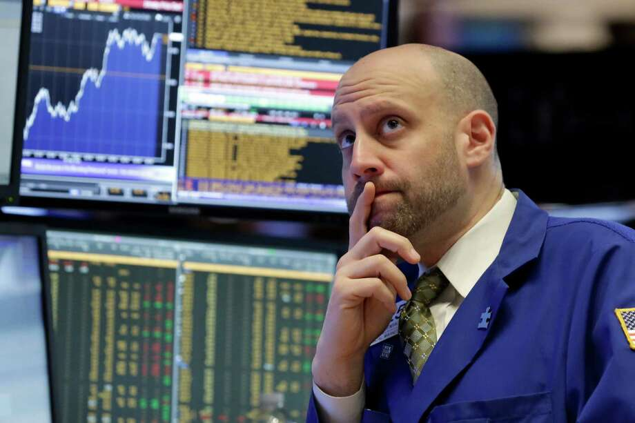 Specialist Meric Greenbaum works on the floor of the New York Stock Exchange.  Photo: Richard Drew, STF / Copyright 2016 The Associated Press. All rights reserved. This material may not be published, broadcast, rewritten or redistribu