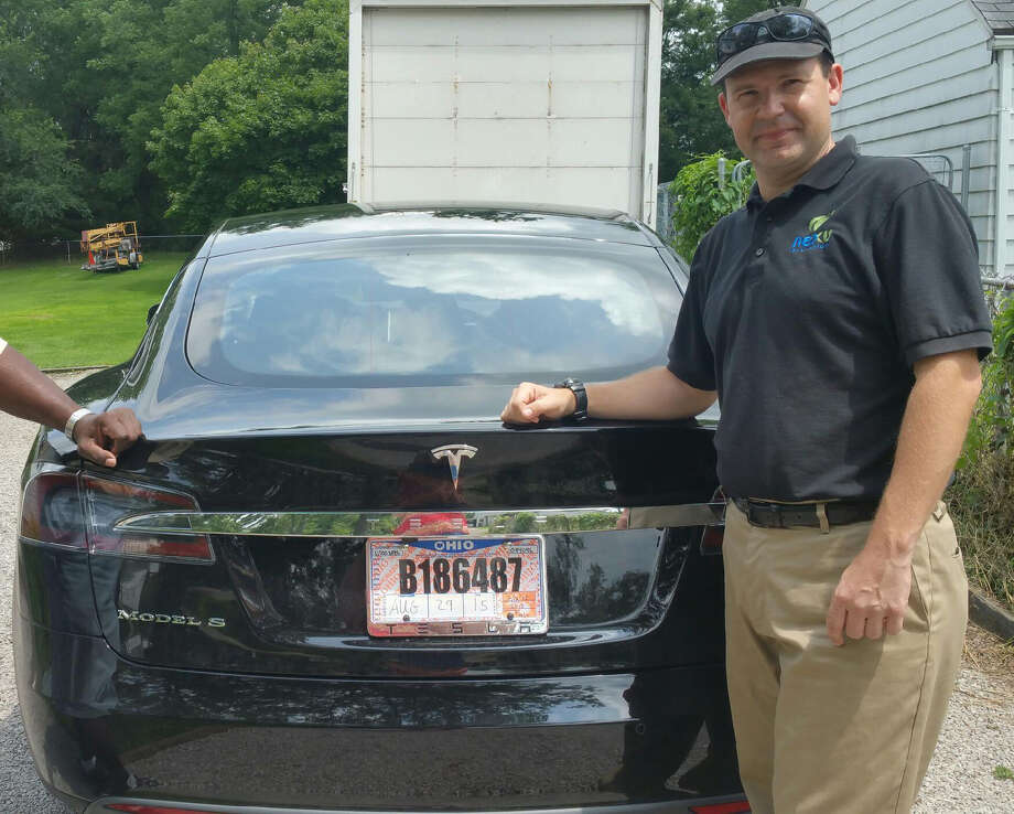 In this 2015 photo provided by one of his  neighbors,  Joshua Brown shows off his  new Tesla Model S  in Canton, Ohio.  Photo: Krista Kitchen, HONS / Krista Kitchen