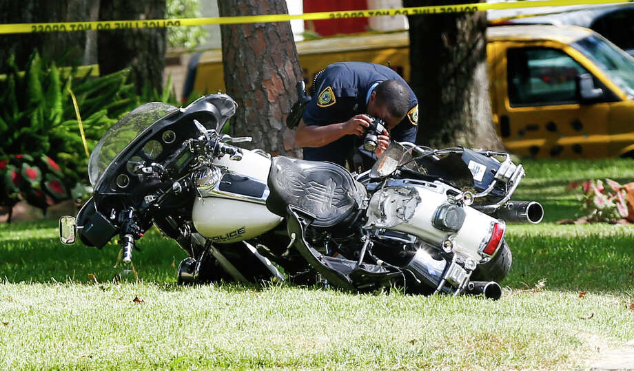 Officer Anthony Zarate lost control of his motorcycle Tuesday in the 8500 block of Ferris, hitting a landscaping crew's trailer. He was a seven-year veteran of the Bellaire Police Department. Photo: Steve Gonzales / © 2016 Houston Chronicle