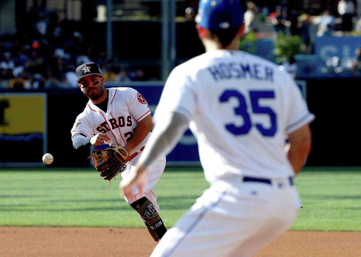 American League's Jose Altuve, of the Houston Astros, throws to American League's Eric Hosmer, of the Kansas City Royals, on a Bryce Harper ground out during the first inning of the MLB baseball All-Star Game, Tuesday, July 12, 2016, in San Diego. (AP Photo/Lenny Ignelzi)